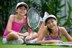 young girls with tennis racquets