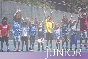 Junior-Kids-reaching-for-sky-on-tennis-court