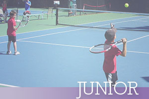 Junior-Serving-tennis-ball